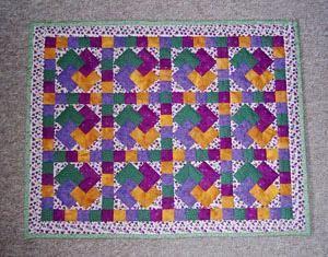 Patchwork sengetæppe mønster